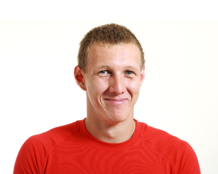 Cheerful young man in red shirt isolated over white photo