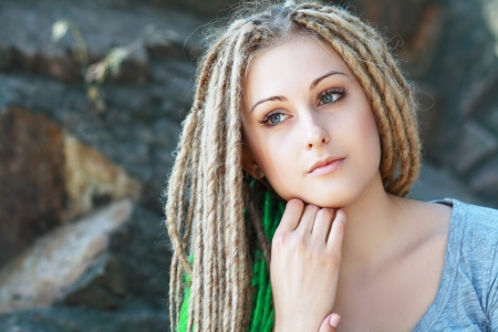 dreads: Dreadlocks. Fashion hairstyle with dreads - beauty woman face Stock Photo