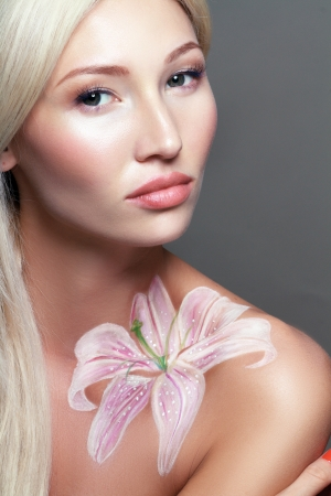 Beautiful fantasy flower body-art close-up portrait of a beautiful  multirace blond womanl  photo