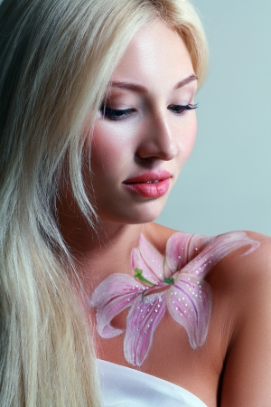 Beautiful fantasy flower body-art close-up portrait of a beautiful photo