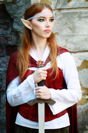 Elf princess close up holding the sword in fantasy world