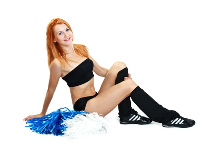 Pretty cheerleader with pom pom on a white background photo