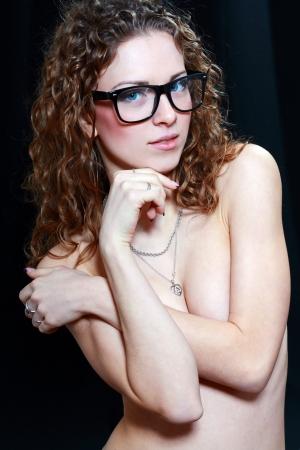 girls naked: Сексуальная девушка в очках на черном фоне Фото со стока
