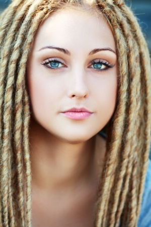 Dreadlocks. Fashion hairstyle with dreads - beauty woman face photo