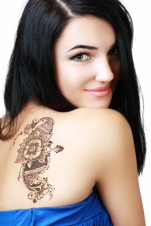Beautiful girl portrait painted Mehandi fresh applied henna on her back photo