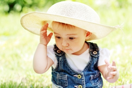 Cute baby girl portrait outdoor in summer day photo