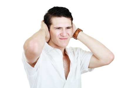 Man holding his hands up to his ears trying to mute all the voices he hears  photo