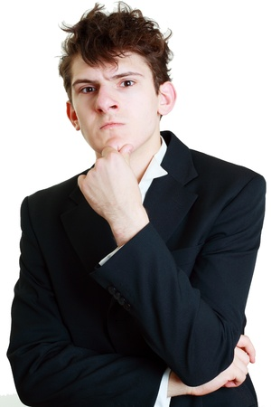 Funny portrait of a young businessman thinking hard photo