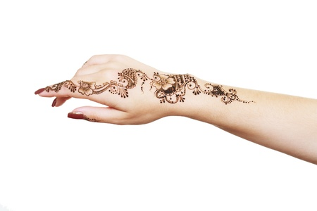 Image detail of henna being applied to hand isolated over whit