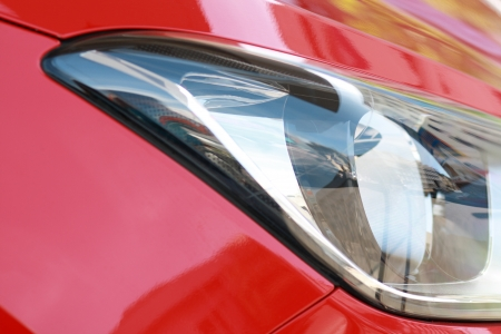 Close Up of a New Red Car Headlight photo