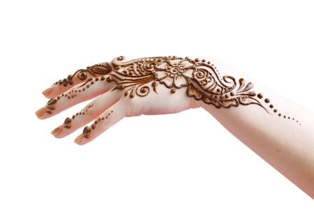 Image detail of henna being applied to hand isolated over whit photo