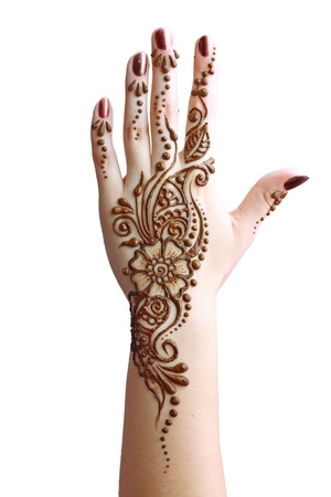 henna tattoo: Image detail of henna being applied to hand isolated over whit
