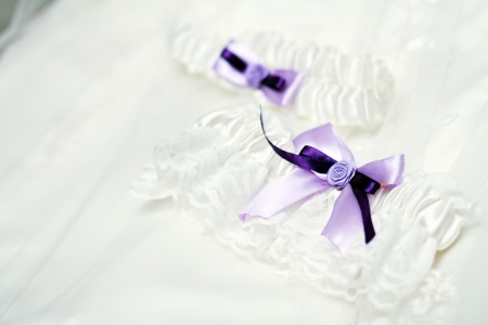 garter belt: The garter of the bride laying on a pillow and prepared for wedd