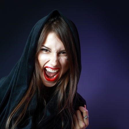Halloween Vampire Beautiful Woman over black with nasty grean photo