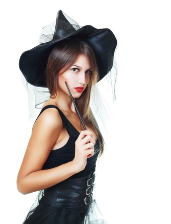 pretty young brunette witch, isolated against white background  photo