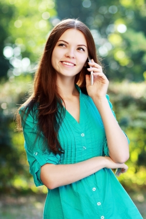 beautiful happy smiling young woman using mobile photo