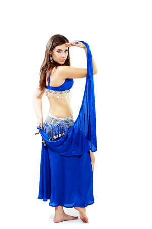 Young beautiful belly dancer girl in a blue costume photo