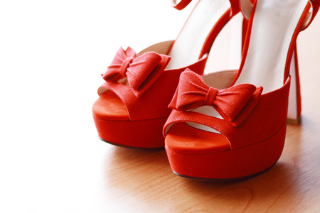 Red women high heel shoes closeup on white background photo
