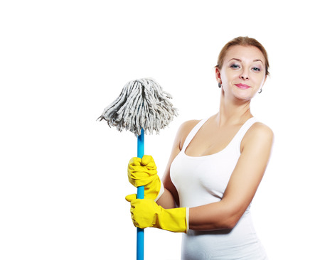 cleaning women holding broom and wearing yellow gloves photo