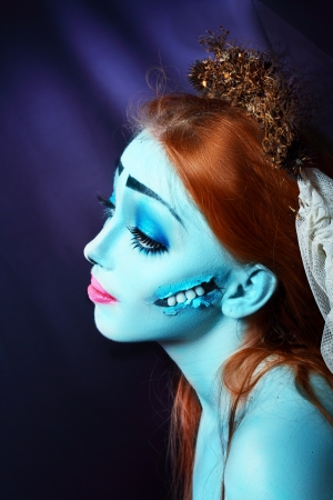 daunting: Halloween beautiful model with perfect corpse bride make up close up. Pretty zomdie or ghost concept. Sad hero