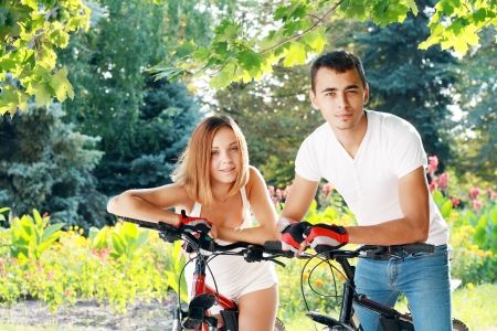 Fitness healthy beautiful young couple on their bikes photo