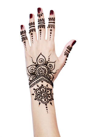 applied: Image detail of henna being applied to hand isolated over white
