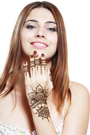 mehandi: Beautiful girl happy smiling have painted Mehandi fresh applied henna on her hand Stock Photo