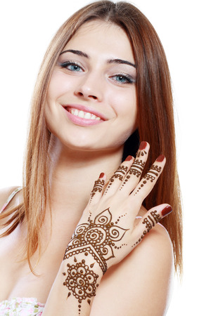 Beautiful girl happy smiling have painted Mehandi fresh applied henna on her hand photo