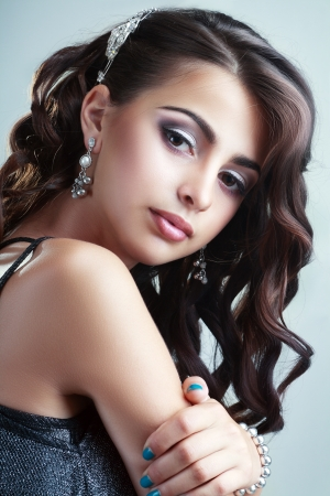 Fashion Beauty Portrait of teen model girl. Healthy Hair. Hairstyle. Holiday Makeup photo