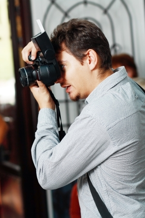 professional Wedding photographer in action photo