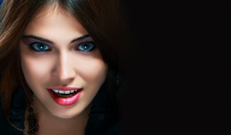 Lady Vamp or Halloween witch Style. Brunette Woman close-up Portrait with copyspace photo
