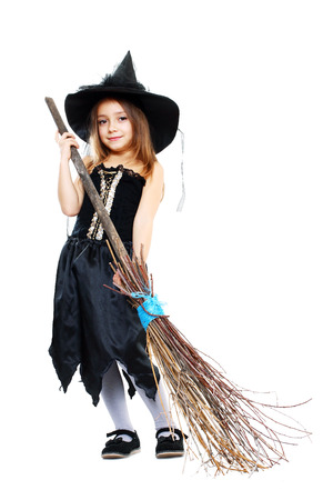 beautiful cute little girl in witch halloween costume hold the broom isolated over white