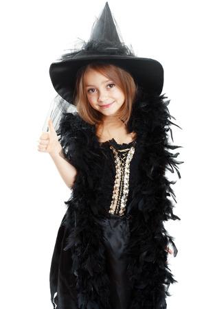 chapeaux: belle petite fille mignonne en costume de Halloween de montrer le pouce et souriant Banque d'images