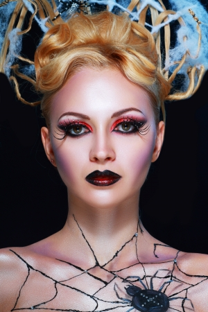 night vampire style with perfect make up and body-art photo