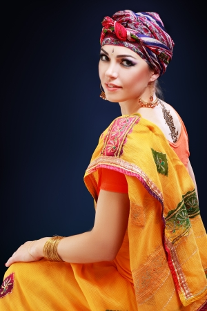 ceremonial make up: Beautiful woman portrait with painted Mehandi fresh pattern applied henna on her back  Stock Photo