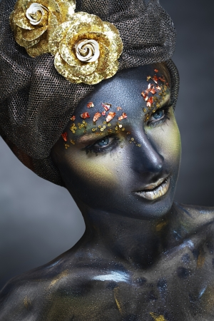 eyeshades: art photo of a beautiful woman with black face. Art face art fantasy make up Stock Photo