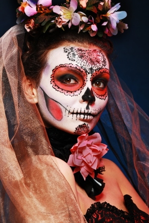 sexy santa girl: halloween make up sugar skull beautiful model with perfect hairstyle. Santa Muerte concept.