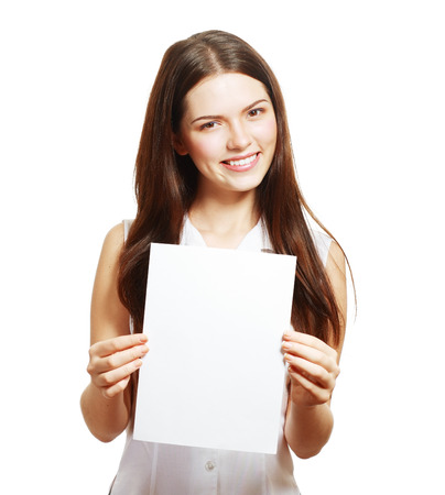 A beautiful woman holds out a blank A4 card Isolated on white background photo