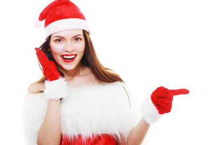 Isolated Young Beautiful Christmas Girl Pointing to copyspace photo
