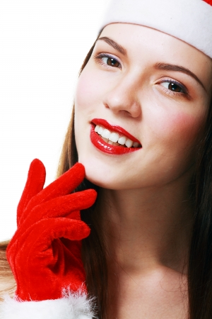 Christmas woman smiling portrait close up. Young woman wearing Santa hat, and red gloves. Closeup photo of cute Asian  Caucasian woman isolated on white background photo