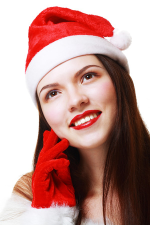 Christmas woman smiling portrait close up. Young woman wearing Santa hat photo