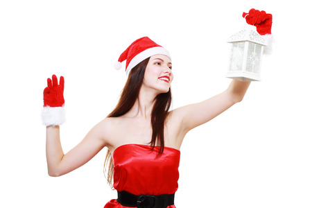 beautiful christmas girl holding white lantern in her hands over white photo