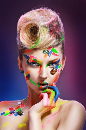 beauty woman with creative make up different colors and crystals photo