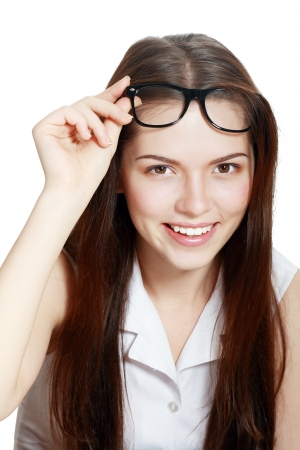 despondency: Friendly College student girl in glasses with books at the desk isolated