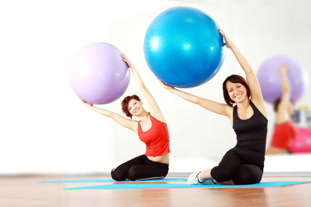 two happy women at the gym with a pilates ball  photo