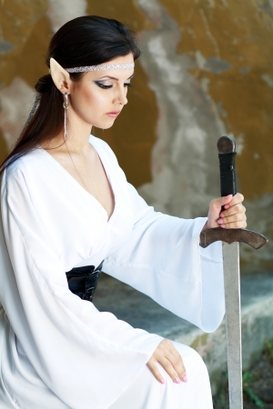 Elf princess close up holding the sword photo
