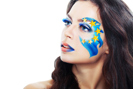 beautiful young woman with creative art make up  - Europe Union flag inspiration painted on face  photo
