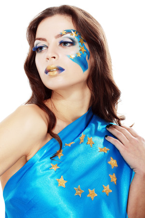 beautiful young woman with creative art make up and EU flag on her face. Supporter protesters in Ukraine photo