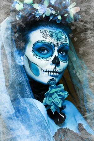 winter make up sugar skull beautiful model with ice. Santa Muerte concept. photo