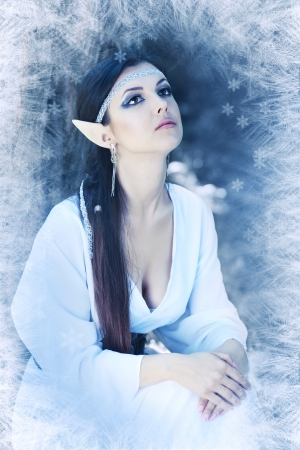 an fairy elf princess with snow ice on winter woodland area photo